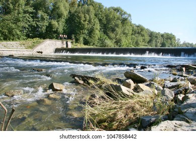 The Becva river was slowed again by a big riverbed, the bank reinforced with a stone wall