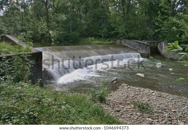 Becva River is slowed down by a large stream lined with tall trees. The turnaround with the locker returns to the main stream