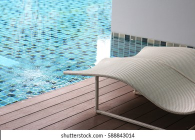 bed beside swimming pool