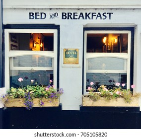 Bed and breakfast two windows with flower baskets wall