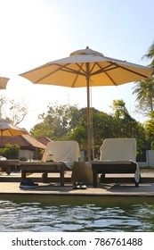 bed or chair with sunshine with sunshade near swimming pool