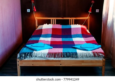 Bed in the hostel. Cozy room in the hostel without people. Booking a room in the hostel.