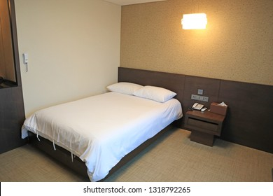 Bed in hotel room for travelers