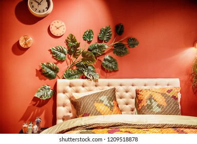 bed in interior with exotic plant as decoration
