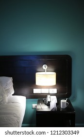 bed lighting in hotel room