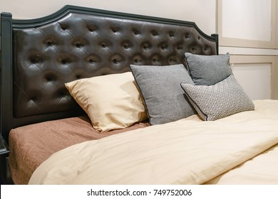 Bed maid-up with clean white pillows and bed sheets in beauty room, Close-up.