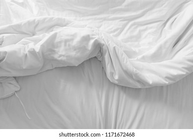 bed with pillow and blanket