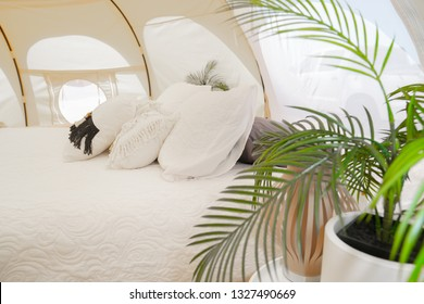 Bed and pillows in luxurious glamping tent and set up at Mount Maunganui