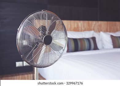 Bed room and metal fan.