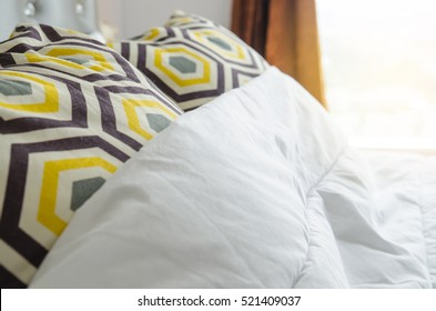 bed sheets and pillows messed up after nights sleep.