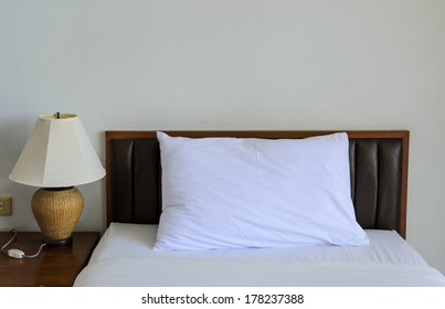 Bed with table lamp
