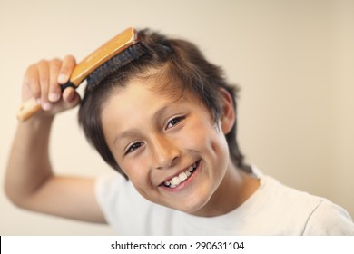 Bed time - boy brushes his hair - very shallow depth of field