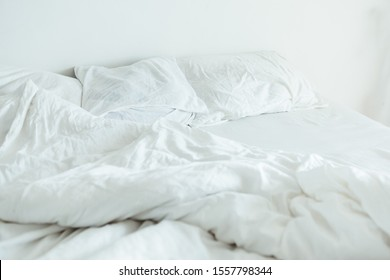 bed with white sheets close up bright light