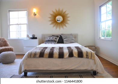 Bed in white staged room