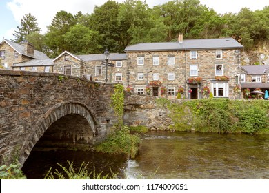 BEDDGELERT - August 29th, 2018: Looking over the River Colwyn at the Prince LLewelyn inn.