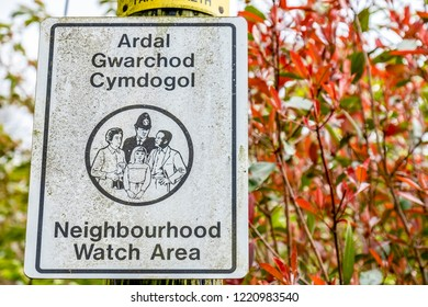 BEDDGELERT / WALES - MAY 03 2018 : Welsh sign with english translation pointing to a neighbourhood watch area.
