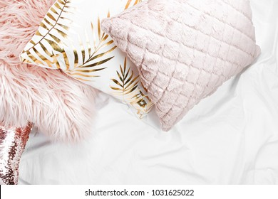 Bedding with a trendy pink pillows . Copy space. Flat lay, top view