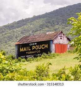 BEDFORD COUNTY,  PA - JULY 9 - Vintage Americana advertising on a barn in Bedford County, Pennsylvania says  Chew Mail Pouch Tobacco. Barns such as this can be seen all across rural America.