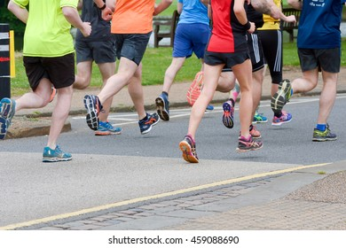 BEDFORD, ENGLAND â?? June 5, 2016: Close up of runners feet as they take part in a 10km running event around Bedford town centre in England