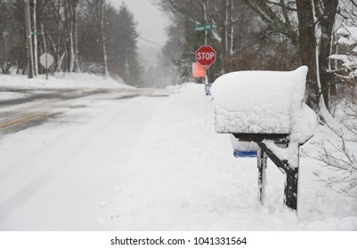 Bedford, N.H., USA, March 7, 2018. A mailbox covered in snow from an overnight storm.