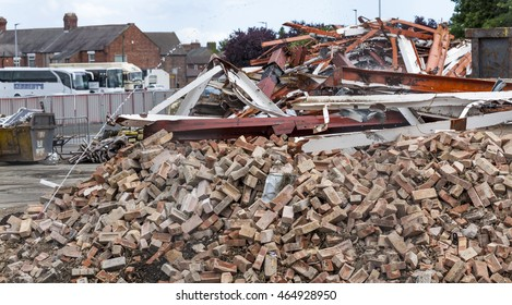 BEDLINGTON, NORTHUMBERLAND, ENGLAND. AUGUST, 3, 2016.  Scene of the demolition site of the old supermarket, showing rubble and machines. August 3, 2016, Bedlington, Northumberland, England, UK.
