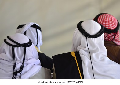 Bedouin arab men wear traditional kufeyas held in place with an igal of camel wool.