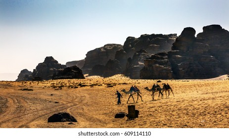 Bedouin Camels Rock Formations Yellow Sand Wadi Rum Valley of the Moon Jordan.  Inhabited by humans since prehistoric times, place where TE Lawrence of Arabia in the early 1900s