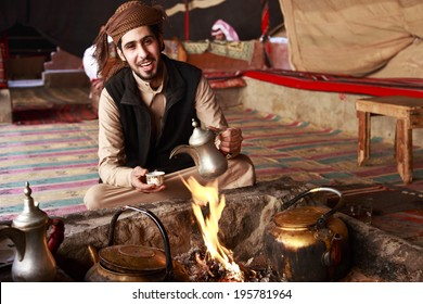 Bedouin man serving Arabic coffee in Wadi Rum,Jordan