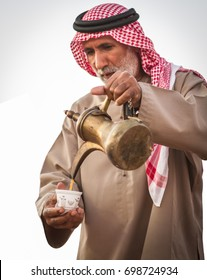 Bedouin old man offers arabic coffee in Al wathba festival in September 12, 2014 Abu Dhabi UAE