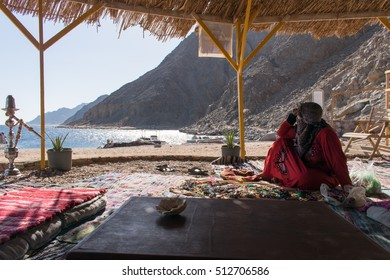 Bedouin woman by Abou Galoum protectorate and diving and relaxation site at Dahab, Egypt