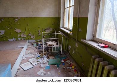 Bedroom in abandoned kindergarten in destroyed village Kopachi (10 km exclusion zone of Chernobyl Nuclear Power Plant), Ukraine