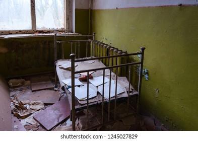Bedroom in abandoned kindergarten in destroyed village of Kopachi, 10 km Chernobyl NPP alienation zone, Ukraine