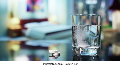 In a bedroom before going to sleep, an effervescent tablet is made to dissolve in a glass of water. Concept: vitamin, medicine, care of your body.
