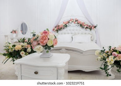 bedroom decorated with artificial flowers