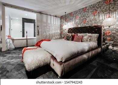 Bedroom with en suite bathroom in new luxury home