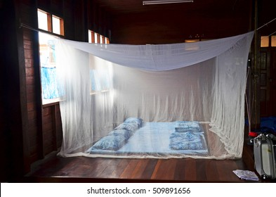 Bedroom and indigo sleeping set old style with bed nets in house of countryside in Phrae, Thailand