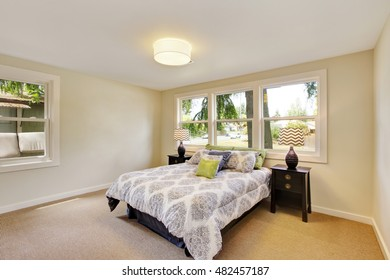 Bedroom interior with beige walls and nice bedding. Northwest, USA