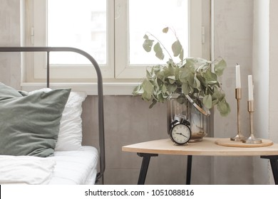 Bedroom interior with clock plant pot on wooden table