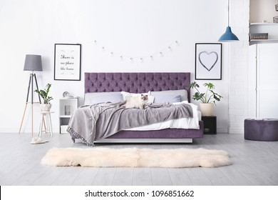 Bedroom interior with comfortable soft bed