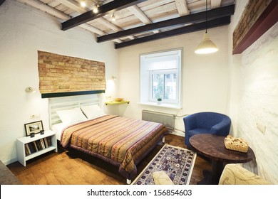 Bedroom - the interior of a cozy studio-type guest house