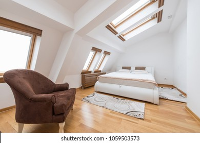Bedroom interior in luxury loft, attic, apartment with roof windows