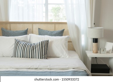 Bedroom interior in luxury loft with wood headboard and side table lamp.