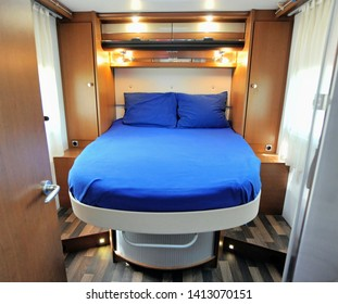 Bedroom Interior of Mobile Home with blue made up bed