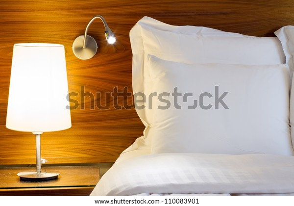 Bedroom modern design with furnishing. Night table with two lamp.