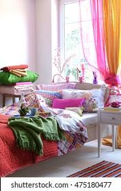 bedroom modern interior green blanket and orange curtain behind window