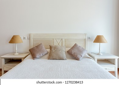 Bedroom in modern style with bed and pillows. Front view