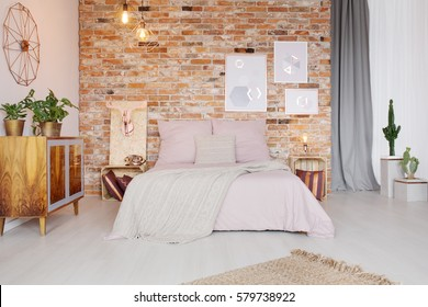 Bedroom with pallet side table and double bed