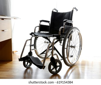 bedroom of the person with disabilities and a Wheelchair