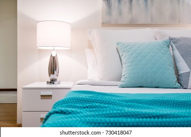 Bedroom setting in modern Australian home. Simple interior design with blue and turquoise colours.
