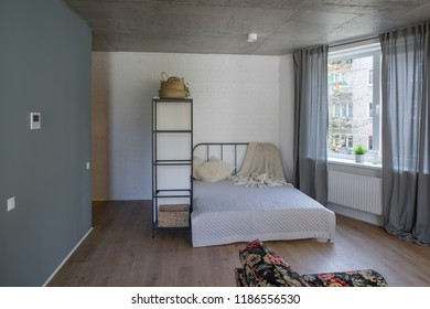 Bedroom in studio apartment. Bed in the apartment.